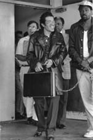 TDCJ inmate and prison reform activist David Ruiz leaving court in 1978 (with briefcase) (Photo By Alan Pogue)